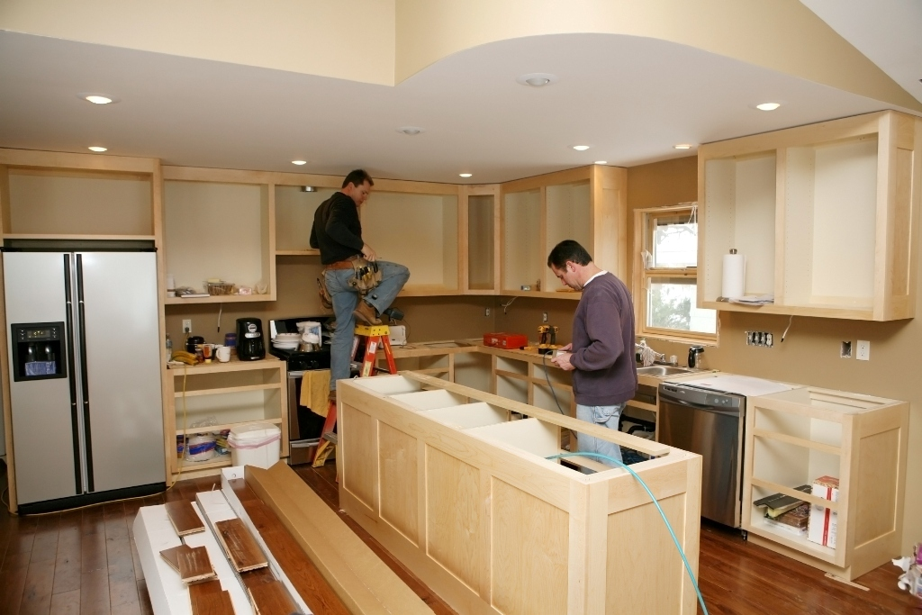 two men remodeling a kitchen of homes for sale in malibu ca