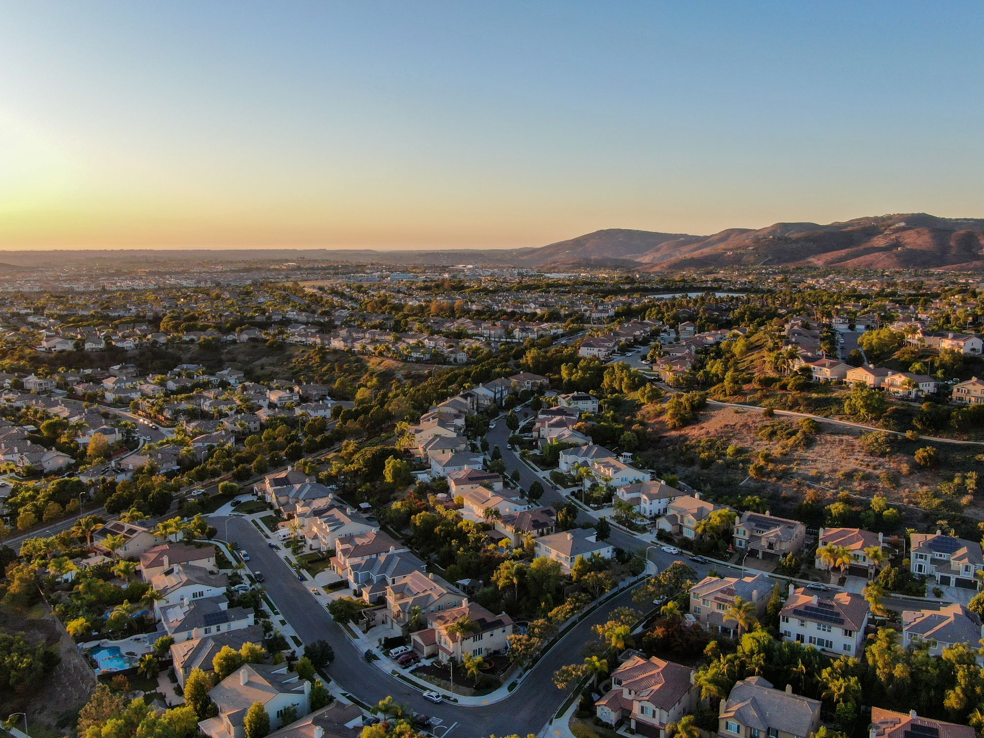 Neighborhood aerial view at dusk